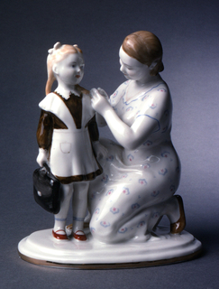 Two figures: a woman in a print dress kneeling, with her hands at the shoulder of a small girl who is in dress and pinafore and holds briefcase; on oval base.