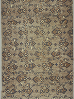 Long cotton sarong (kain panjang) featuring diagonal repeat of medium-sized decorated blade-like motifs with stylized leaves and flowers attached to curving stems alternating with small four-lobed rosettes in dark blue, white, and cocoa brown. Design on a ground of cocoa crackle and five dark wavy parallel comb marks. Two plain selvedges, narrow hem at one end. Reversible.