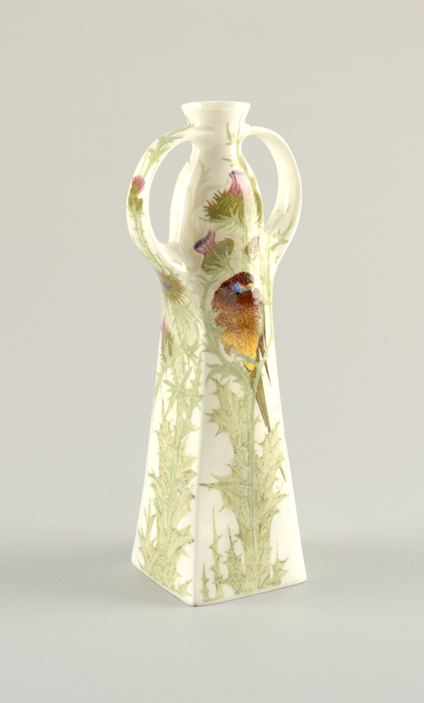 Four-sided tall narrow body, tapering at neck, two flat loop handles; painted with thistles and birds.