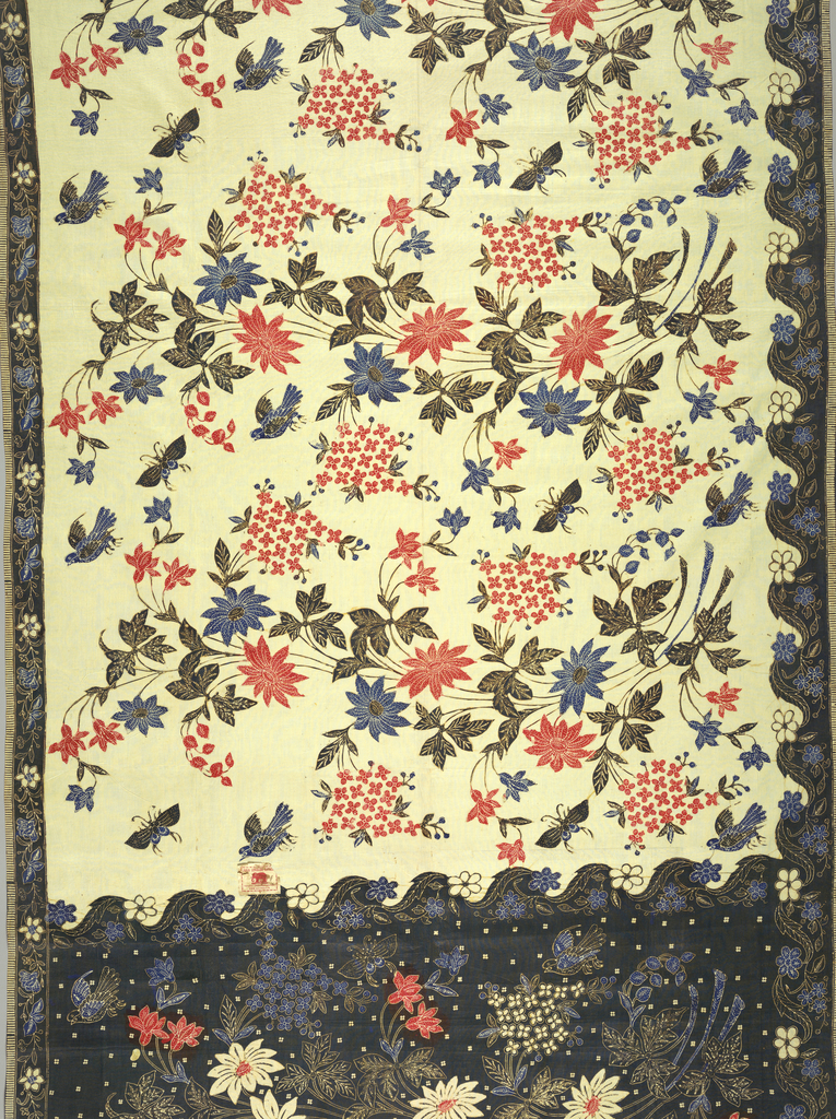 """Sarong with horizontal repeat of large-scale curving floral spray (""""buketan"""" motif) surrounded by birds and butterflies in black, red, and blue on undyed ground. Narrow black side borders with blue and white floral pattern, one scalloped on inner side (a North Javanese batik innovation) and one straight. The head or 'kepala' of the cloth (broad traverse band with different coloring and pattern than remainder) shows one large floral spray (from horizontal repeat) on black ground. Two plain selvedges on long sides; raw edges on ends."""