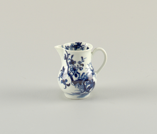 Blue and white jug with floral decoration.