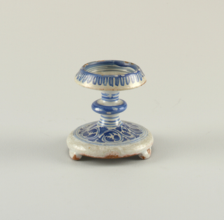 Tazza shape. In the well is a design of a house. Wide base has acanthus scroll motif.