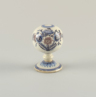 Cobalt blue and manganese purple decoration showing flowers and a bee on globe. Ring of leaves at base of neck. Circles at edge of foot and top of globe.