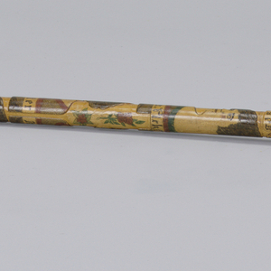 Wood cane with carved, engraved and polychromed decoration depicting American flag and portrait busts of early 20th century film actresses Mary Pickford, Clara Young, Mary Miles Minter, and Bebe Daniels.  Silver handle in octagonal acorn form, and tapered steel tip attached at opposite end.