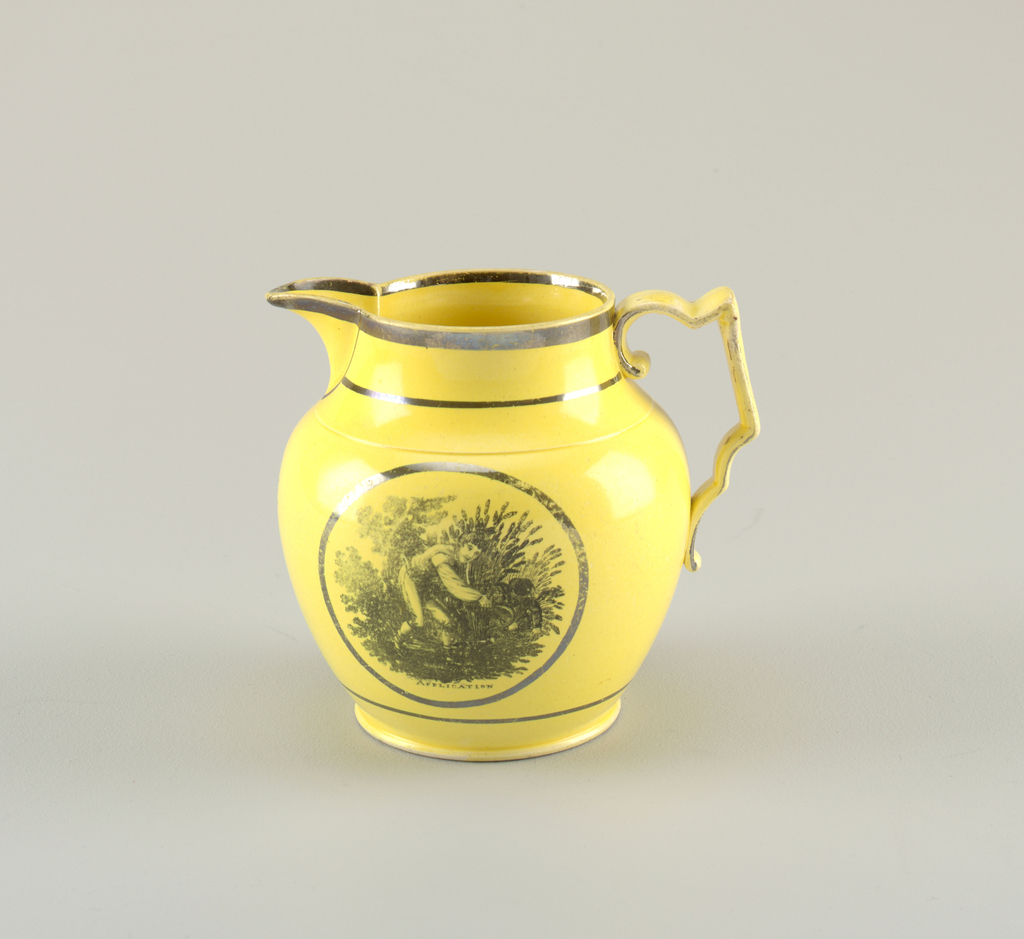 "Bulbous pitcher in yellow with pointed spout and angular and curved handle. Black border on rim and base. Depicts young man collecting wheat in circular frame. Below, inscribed: ""APPLICATION""."
