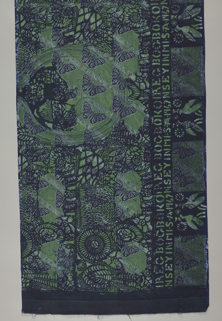 "One of a group of fabrics representing the Silver Jubilee of King George and Queen Mary of England in 1935. Diagonal bands of butterfies and the words ""LABALABA TO BA DIGBOLEGUN"", in pale and dark blue on a green ground. Aonther pattern in dark blue is superimposed over this, with a central medallion with two crowned heads and an all-over pattern of leaves. A band at the bottom bears the inscription ""IREGBOGBOKO NSEYINMI. S.A.1967"" above alternating squares with two birds or butterflies."