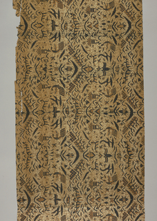 "Batik textile, possibly a long sarong (kain panjang), showing traditional ""semen"" (non-geometric forms like flora and fauna) design in blue, white and tan."