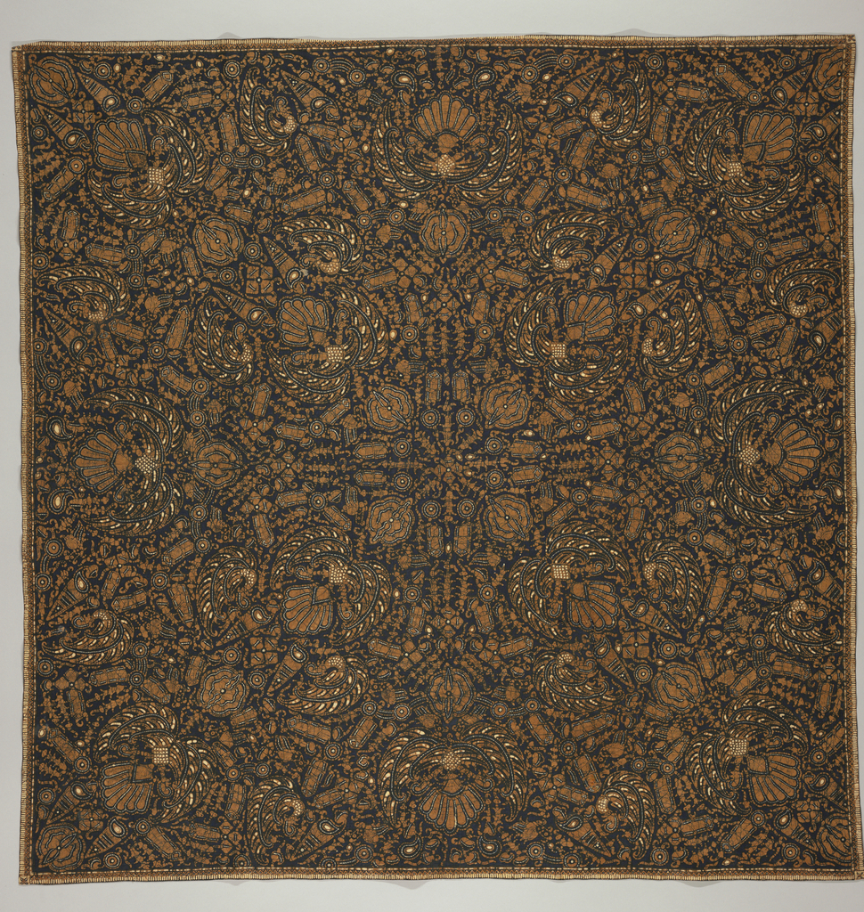 """Square textile (may be a head cloth or 'kain kepala') with symmetrical """"semen"""" (non-geometric forms like flora and fauna) design. Featuring """"sawat"""" motif (wings and tail of Garuda, mount of Vishnu), crayfish, birds, etc. in cinnamon brown with a few white accents, dark blue crackles, and all on a very dark blue ground."""