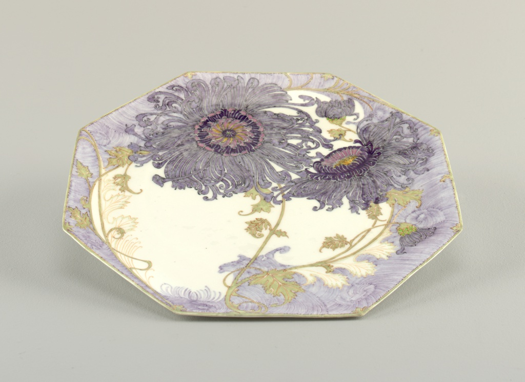 Octagonal, with painted decoration of stylized purple flowers.