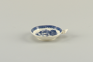 Blue and white decoration. Pierced strainer and scalloped handle.
