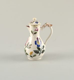 Baluster-form white cruet with short spout, decorated with polychrome flowers. Lid with finial. Bird's head with plume on handle.