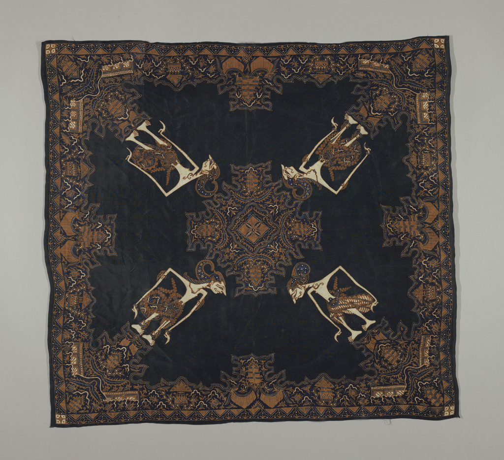 """Silk square in black, dark blue, brown, and cream-white. Shows four """"wayang"""" figures facing diagonally toward center, one of which has a different pattern on his sarong. Outer border and center ornamented with """"ship of the dead"""" and """"sawat"""" (wings and tail of Garuda, mount of Vishnu) motifs, as well as architectural structures."""