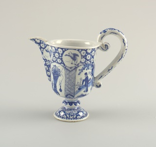 Straight-sided circular body, long pointed spout one side, large looped handle opposite side; domed foot with flattened knop middle of stem; painted in underglaze blue on white with dark outlines (trek), chinoiserie designs of figures and flower vases in reserves, floral and diaper patterns.