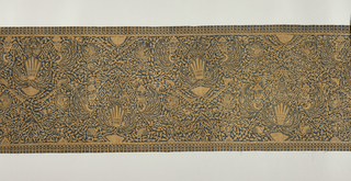 "Shoulder cloth (selendang) with batik design in blue on tan. Features ""sawat"" (wings and tail of Garuda, mount of Vishnu) and ""lar"" (single wing of Garuda) motifs. Field shows organic forms and border (4cm or 1.5"") with design of tassels."