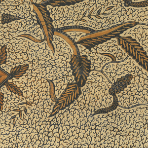 """Long batik sarong (kain panjang) in dark blue, dark brown, and light brown on cream-colored ground. Shows the """"semen"""" motif of leaves, flowers, and plants evenly covering the cloth."""