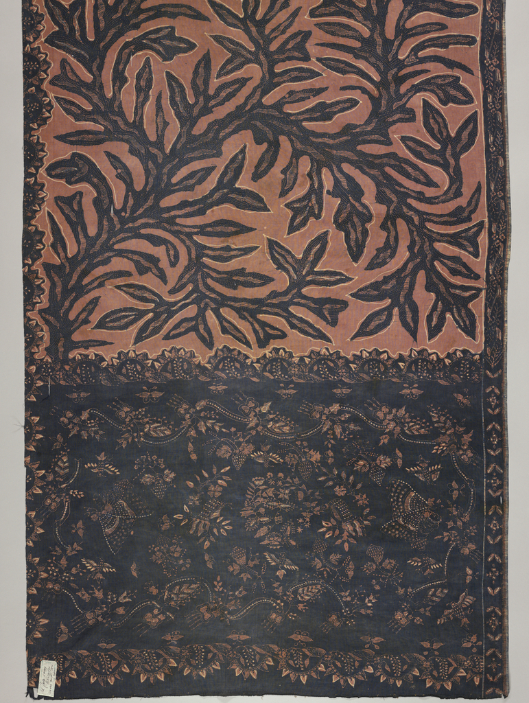 Batik sarong in brown, pink, and dark blue. Dark blue seaweed pattern placed freely over the pink-brown ground in the body or 'badan' of the piece. The head or 'kepala' (broad band with different coloring and pattern than remainder) shows dark ground with floral pattern.