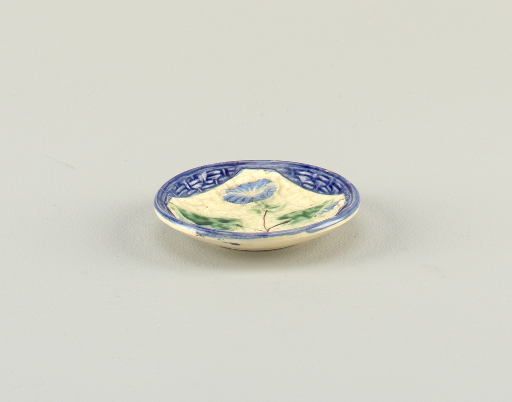 Molded basket pattern, with relief kerchief and morning glory, in blue and green.