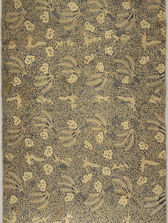 Long horizontal rectangular sarong (kain panjang) in blue and light brown features a repeat of a curving floral vine, birds, and other creatures. The ground is covered by thick tendrils. There are no borders.