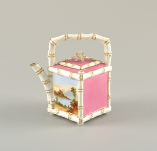 Square cream pot in pink with white and gilt angled bamboo edges. Triangular spout at corner opposite handle. Decorated with landscape view on one side.