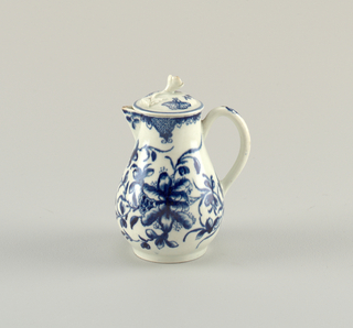 Pear-shaped, with painted spout, loop handle, on base ring. Decorated with large flowers and buds on leafy stems, surmounted by a border containing triangular latticed panels. Cover with knob in form of a flower on stem. Decorated with butterfly and floral spray in blue.