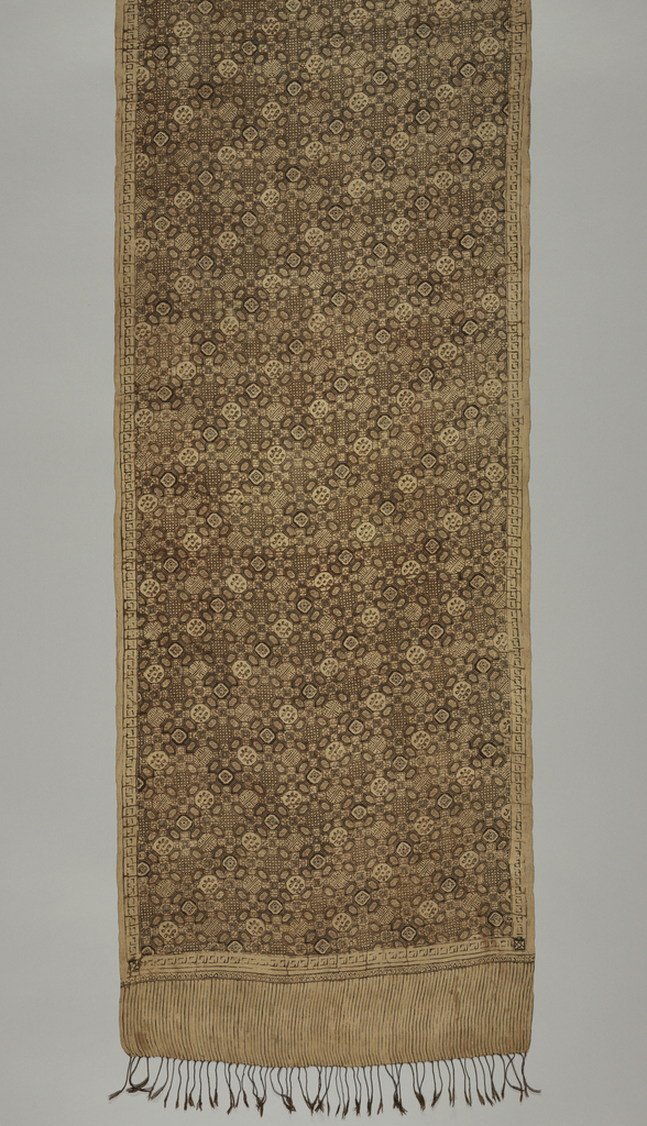 "Silk textile, probably a shoulder cloth (selendang) or breast cloth (kemben), with all-over geometric pattern (""ceplokkan"" motif) in dark brown and cream-white. Outer edge decorated with narrow border similar to the running-key design. Fringed."