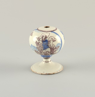 On globe a cartouche of gesturing figure, and a floral design. Cobalt blue and manganese purple.