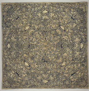 "Batik square head cloth (kain kepala) with aAll-over pattern radiating from the center consisting of bird or fish-like figures, underwater-like plant forms, and the ""sawat"" motif (wings and tail of Garuda, mount of Vishnu) in light brown and ivory on a dark blue ground."