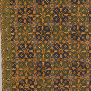 """A geometrical """"ceplokkan motif"""", symmetrically arranged, covers the larger part of the sarong. One end is ornamented with the """"tumpal"""" motif (row of isosceles triangles) and small floral designs. Narrow ornamental borders edge the four sides. Batiked in two shades of blue, light brown, and green (yellow over green)."""