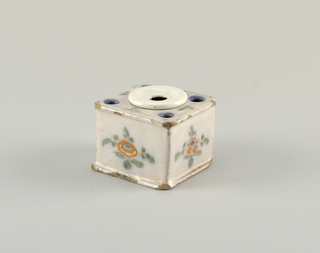 Ink well with polychrome floral decoration. Modern ceramic center well.