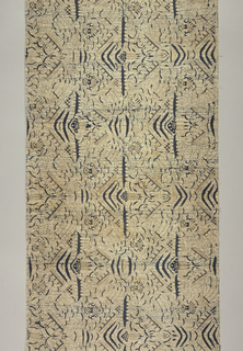 "A sarong featuring the ""semen"" motif--a design of finely drawn scrolling lines, tablets, dotted areas, etc. in dark blue and light tan on white ground."