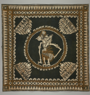 "Cotton square, possibly a head cloth (kain kepala), showing a ""wayang"" figure (a puppet acting out the heroic poem of the Mahabharata, describing the battle between Rama, God-hero, and the demons of Rawana) encircled in the center. All four corners ornamented with the stupa motif. Colors: black, brown, and white."