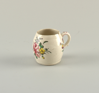 Sceaux mustard pot with handle. Painted floral sprays.