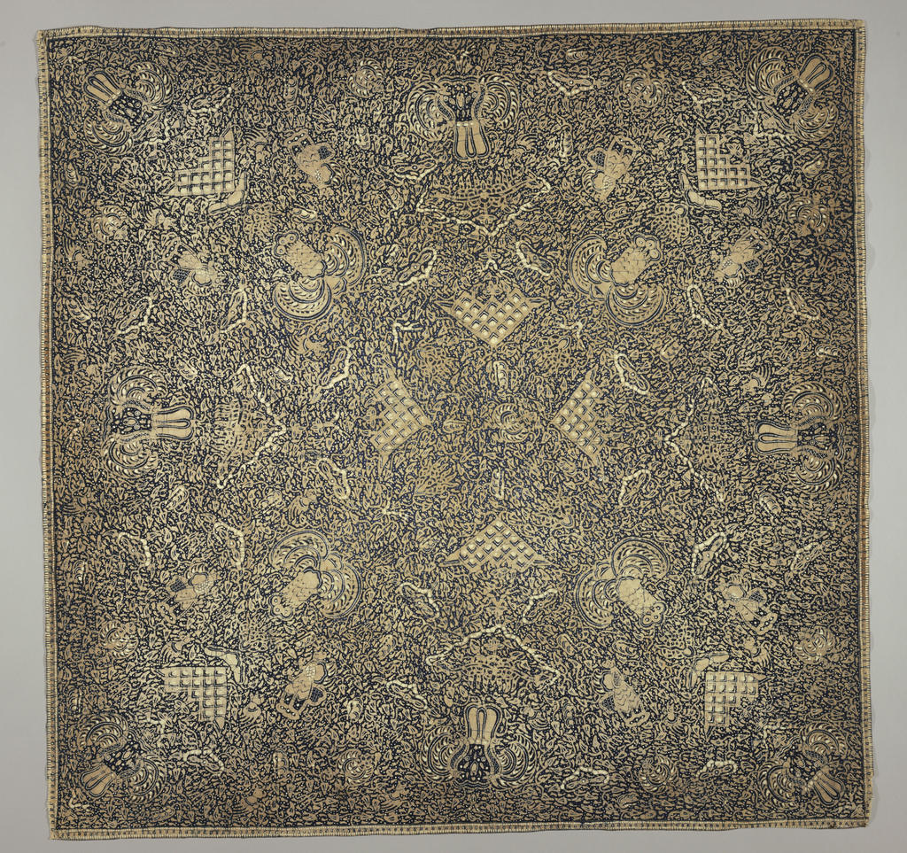 "Cotton square, possibly a head cloth (kain kepala), in dark blue, light brown, and white. Dark blue ground showing numerous white dots known as ""gabah sinawur"" or 'grains of rice'. The ""semen"" (curling tendrils and other non-geometric forms) and ""sawat"" (wings and tail of Garuda, mount of Vishnu) motifs are also used."