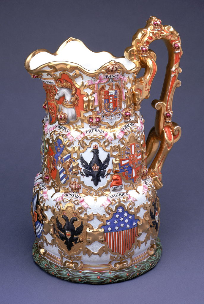 Parian ware, with coats of arms of the nations contributing to the exhibition of 1855 in relief, with strapwork ornament.