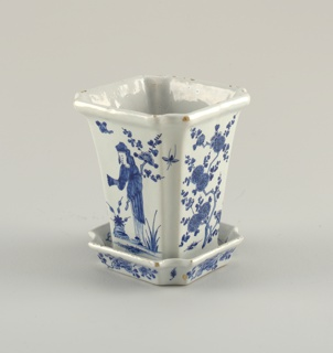 Four-sided pot with champfered corners, slightly flaring sides, everted rim, molded base, bottom pierced with 5 holes; saucer of conforming shape with short raised everted rim; painted underglaze blue on white on sides of pot with Chinese figures and prunus blossoms, on saucer with floral sprays.