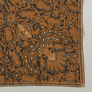 """A square scarf or headcloth (kain kepala) with design in brown, blue, and white on black ground. Much use of small white dots. Conventionalized bird and animal motifs including """"sawat"""" (wings and tail of Garuda, the mount of Vishnu)."""