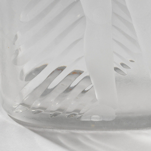 Partially frosted glass vase, with Native American male figure in feathered headdress and loin cloth, standing with arms crossed, engraved on front.  Vase, elongated oval shape in plan.