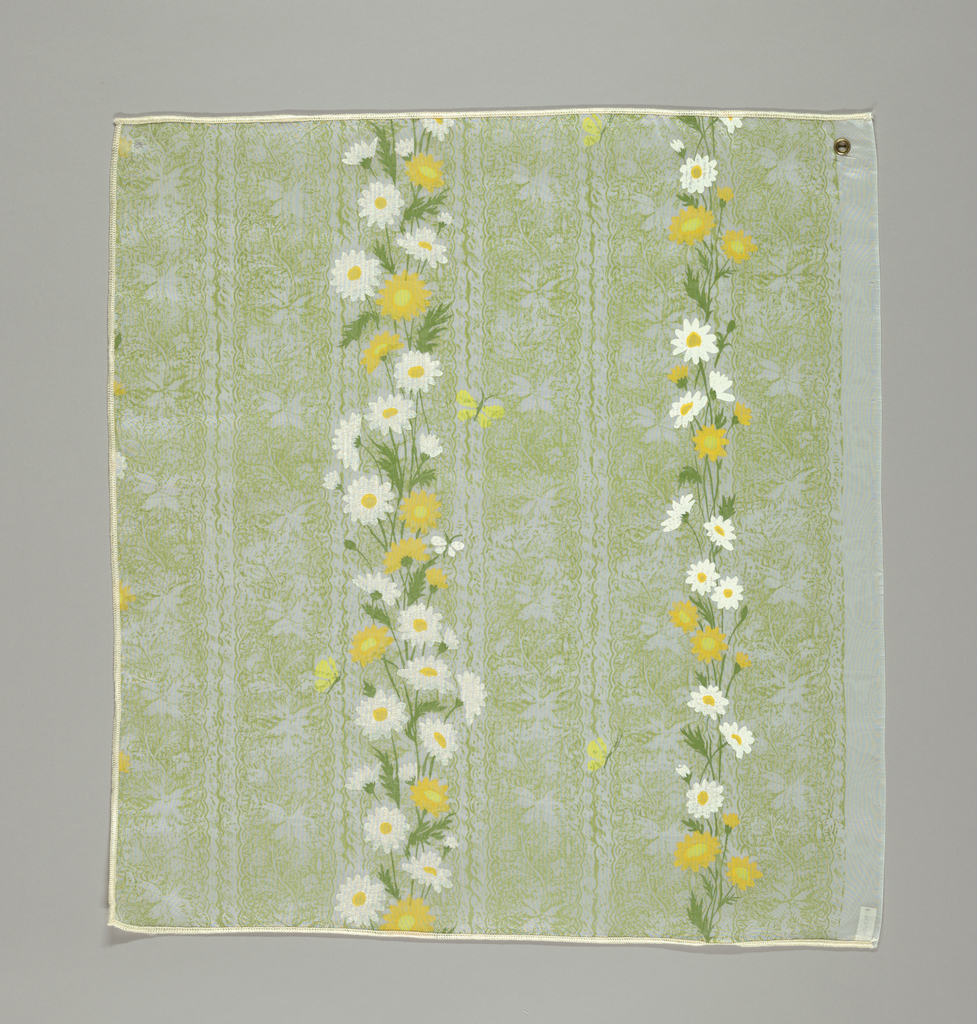 Vertical stripes of yellow and white daisies with green stems and leaves are printed against a background of leaf pattern printed in green.