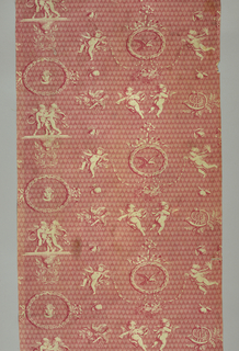 Cupids – flying, holding garlands and wrestling – on an allover background of hearts and arrows in a rosy red. Fabric is a 20th century copy of an ealier design by J.B. Huet for Oberkampf at Jouy.