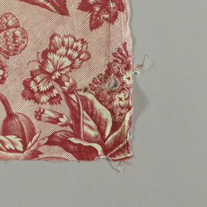 Long narrow panel printed in red on white showing design of flowers, insects and birds. Incomplete repeat.