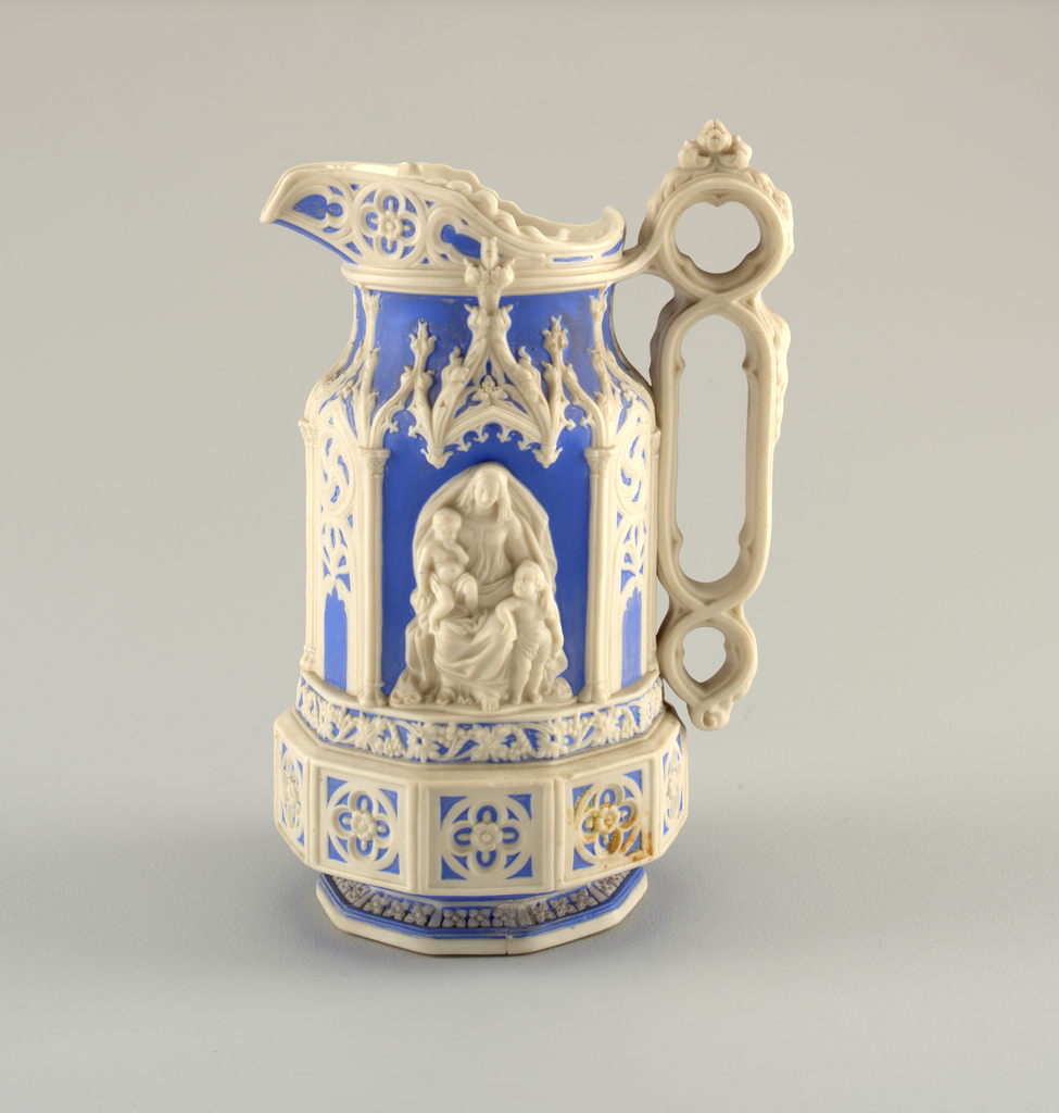 Jug with pewter lid in blue and white by Charles Meigh.  Repaired foot-base.