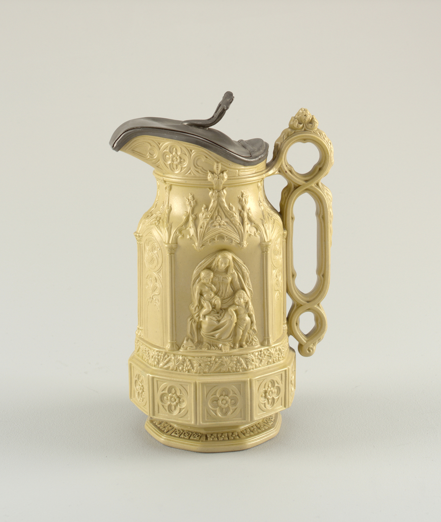 """""""Minster"""" jug with pewter lid in ercu (green-beige)  by Charles Meigh."""