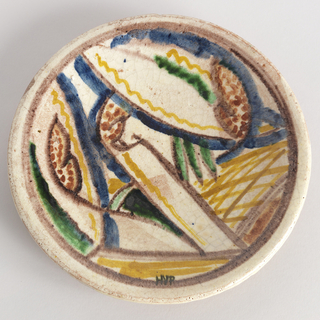 Circular plate with abstract decoration of blue, magenta, yellow and green lines, hatching, and dots on white ground; narrow rim with magenta band surrounding central abstract design.