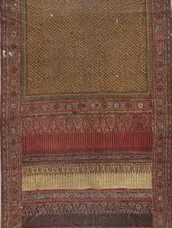 Long narrow panel with rectangular field with diagonal lattice framing small flowering pants on a yellow/ochre background: wide border at each end in four sections - each decorated with pendant forms, top and bottom red background and remailing two yellow/ochre on deep purple ground. Continuous outer band framing field and end borders patterned by a repeat of two alternating medallions with floral guard stripe on each side.  (MS'72)