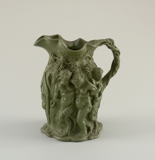 "The dark green version of this pattern was issued in 1831 as model number 19.  While many companies produced versions of the ""Silenus"" jug, the dark green color is unique to Minton."