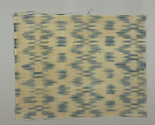 Length of cotton and linen cloth with horizontal blazes of shaded blue from ikat warp. Cloth selvedge terminating in cord.