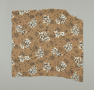Sample of silk in golden tan with squiggly black lines. White of the ground shows through and forms an abstract floral design.