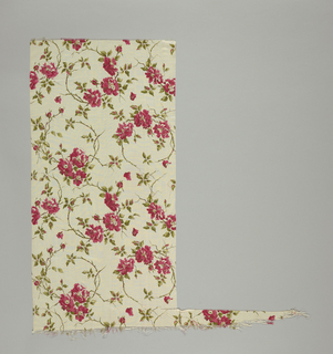 White ground with a design of roses printed in red, green and brown.
