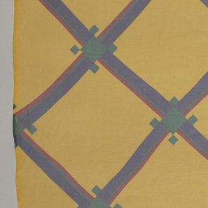 Diagonal plaid of red, green and blue on bright yellow