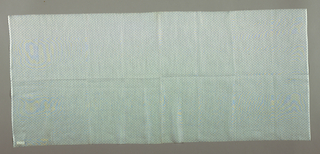 Length of light blue cotton patterned by rows of white asterisk-shapes.